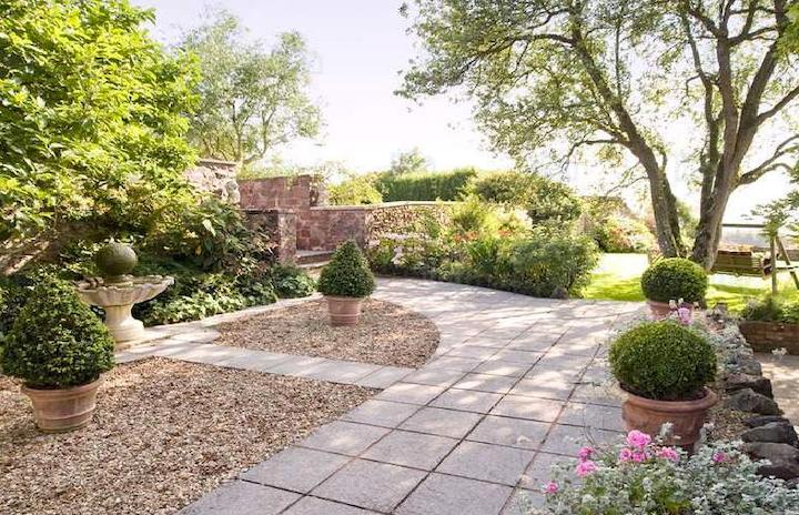 May contain: yard, outdoors, nature, path, vegetation, plant, walkway, and bush