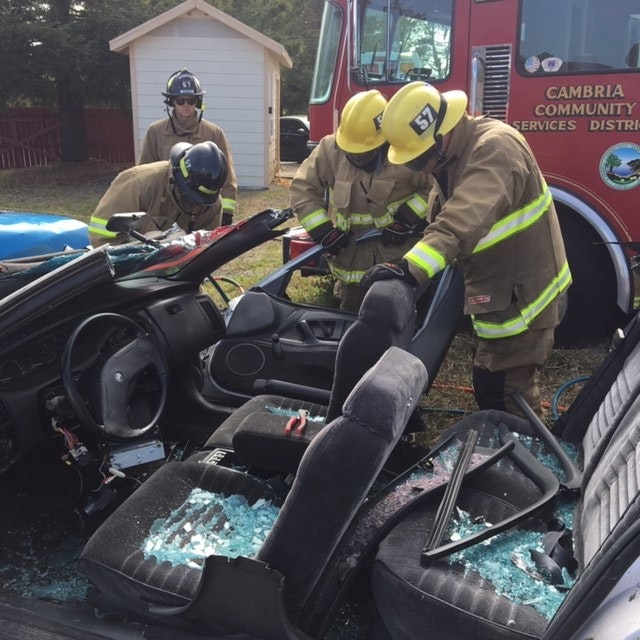 May contain: person, human, motorcycle, transportation, vehicle, and fireman