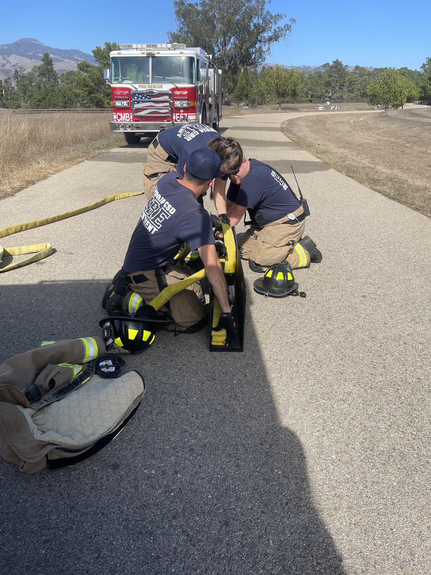 May contain: person, human, tarmac, asphalt, and fireman