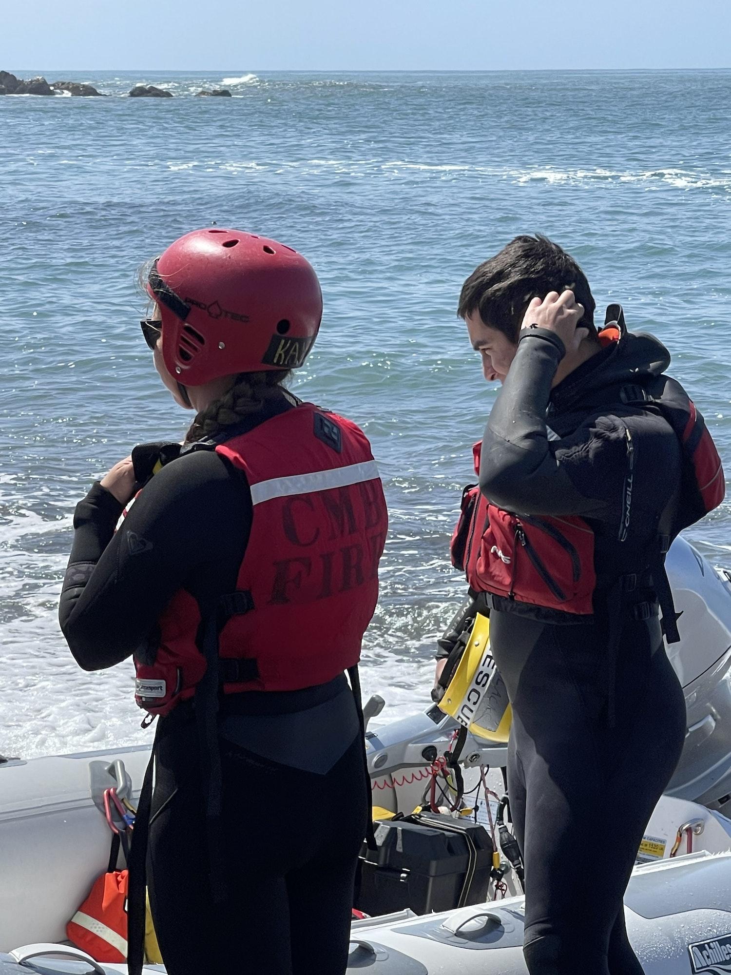 May contain: clothing, apparel, helmet, person, human, crash helmet, lifejacket, and vest