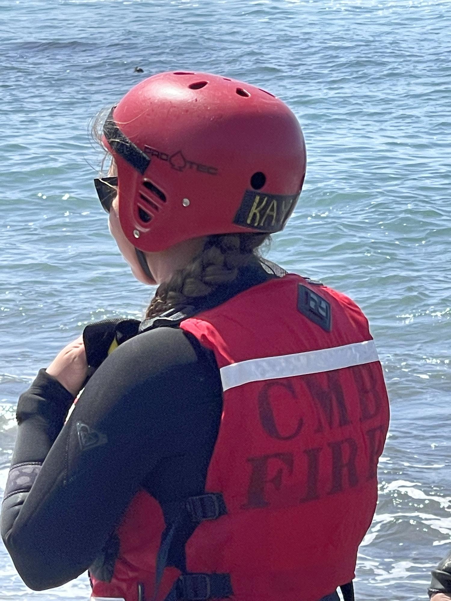 May contain: clothing, apparel, helmet, lifejacket, vest, person, human, and crash helmet