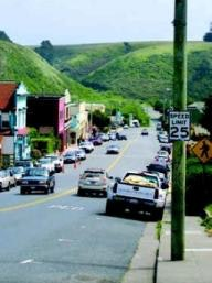 View of downtown Point Arena street with green hills