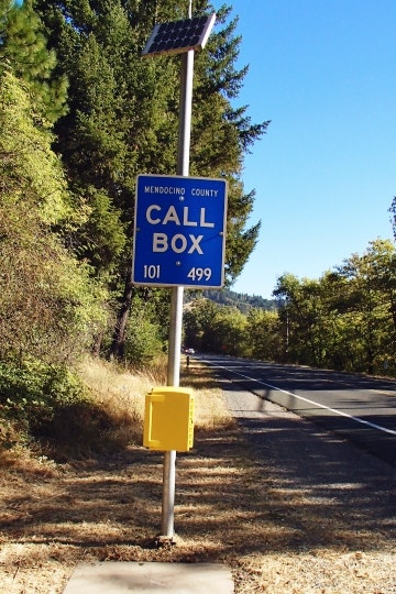 highway, emergency call box. pole, sign, solar panel