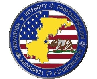 May contain: logo, symbol, trademark, and badge