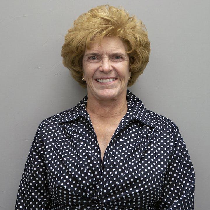 headshot of Gail Whipple in polka dot blouse