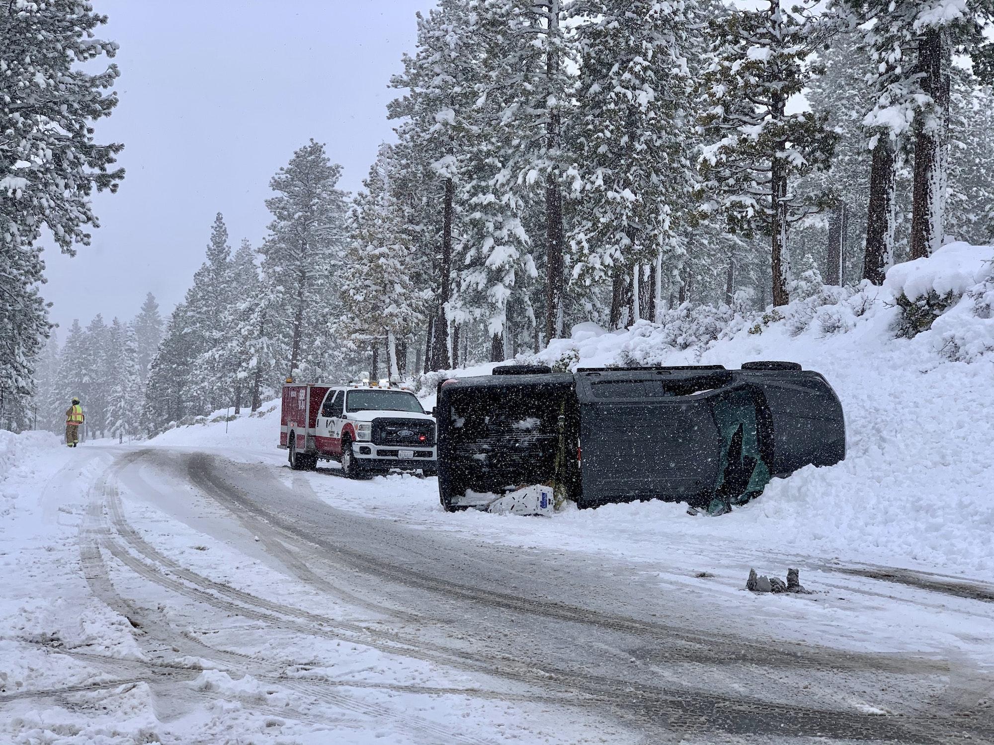 Snowy black truck rollover on Highway 89 N