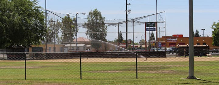 May contain: building, baseball field, arena, softball, team, sports, sport, team sport, baseball, and field