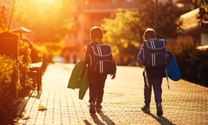 May contain: person, walking, human, backpack, and bag