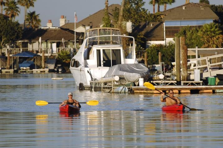 May contain: person, human, boat, vehicle, transportation, and rowboat