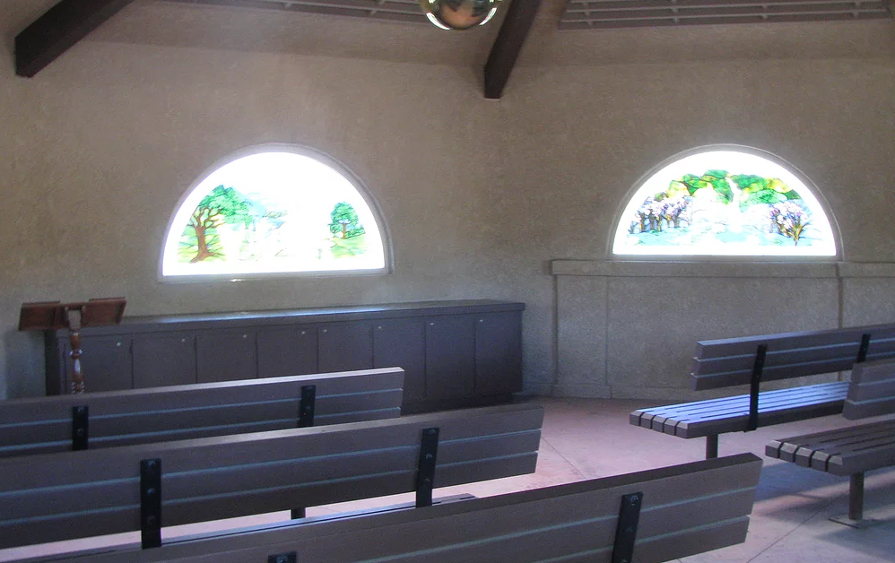 May contain: bench, interior of chapel, stained glass windows