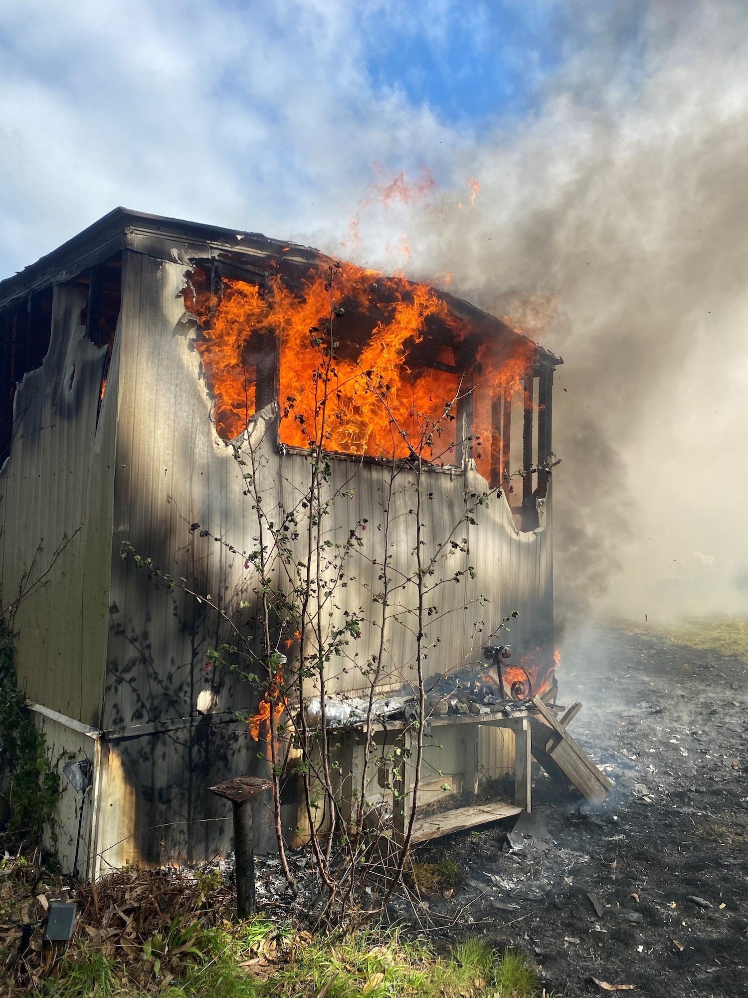 Large flames burning mobile home