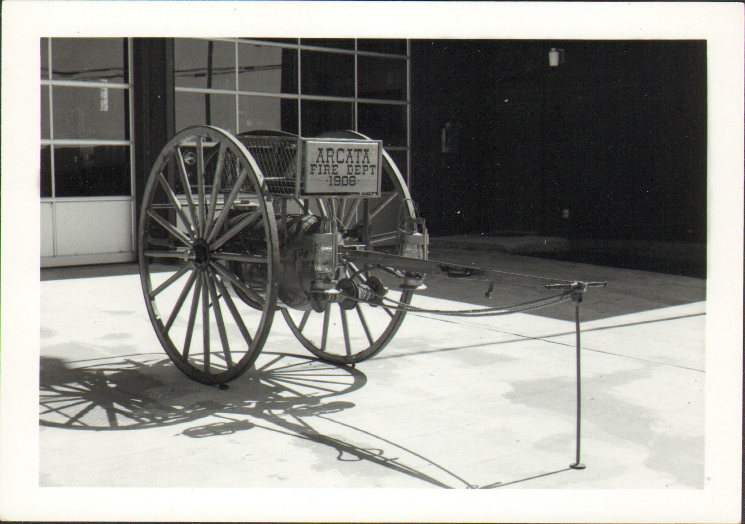 Photo of vintage chemical cart in front of Mad River Station