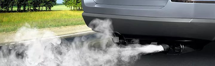 Rear end of a car with exhaust.