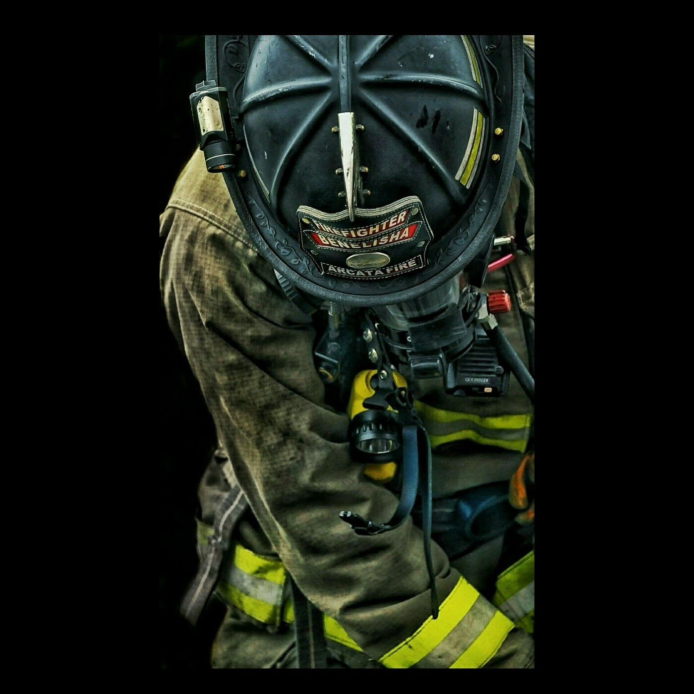 Fire fighter with safety gear.
