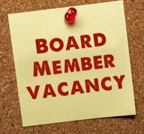 Yellow sticky on cork board reading Board Member Vacancy