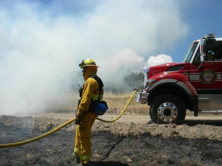 Firefighter at a wildland fire with E8239.