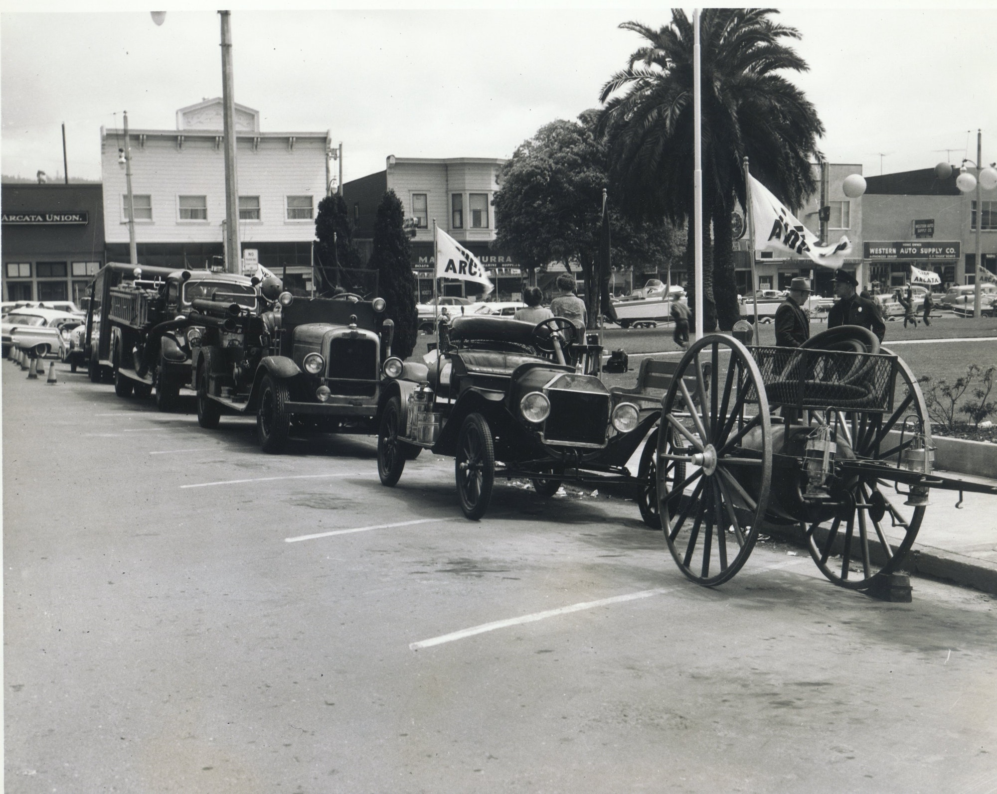 VIntage photo of Arcata Fire apparatus lining up for a parade.