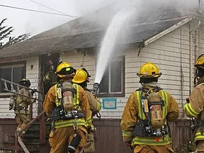 A group of firefighters at a fire.