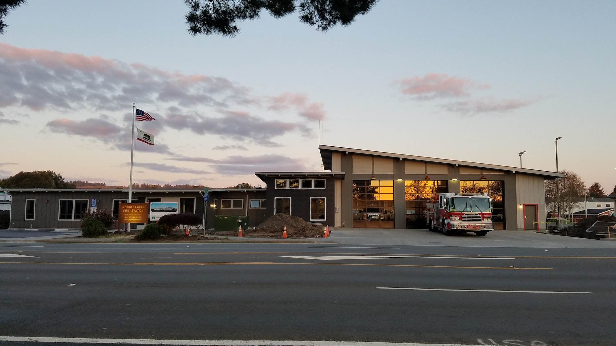 Photo of McKinleyville Station with an engine in the driveway.