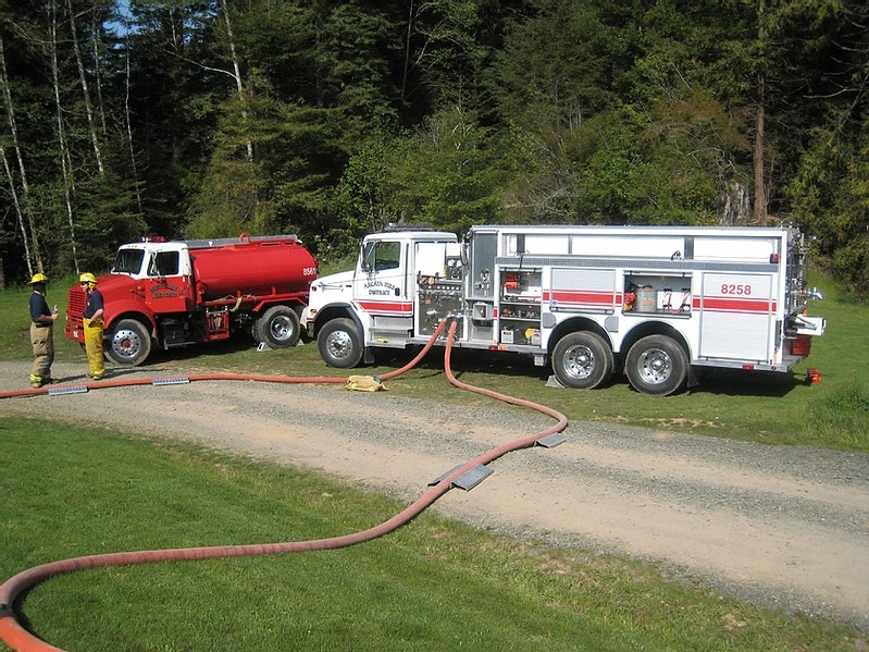 Two water tenders in operation at a fire.