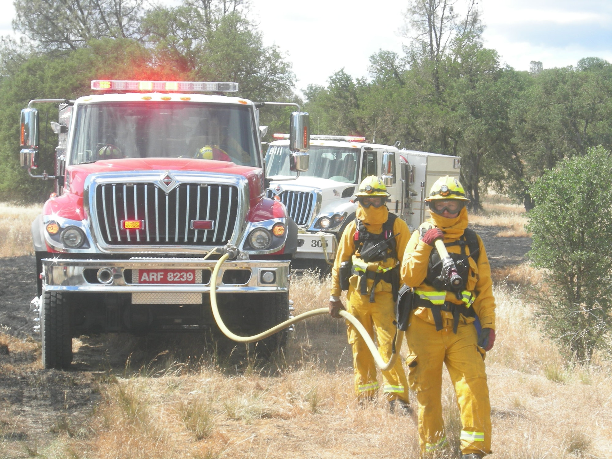 Firefighters performing pump and roll on a training burn at Fort Hunter Ligget.