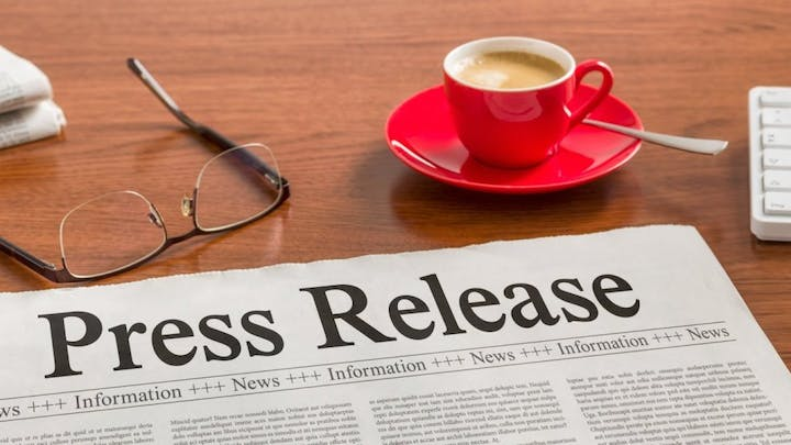 newspaper reading Press Release, glasses,  accessory, coffee cup, and spoon