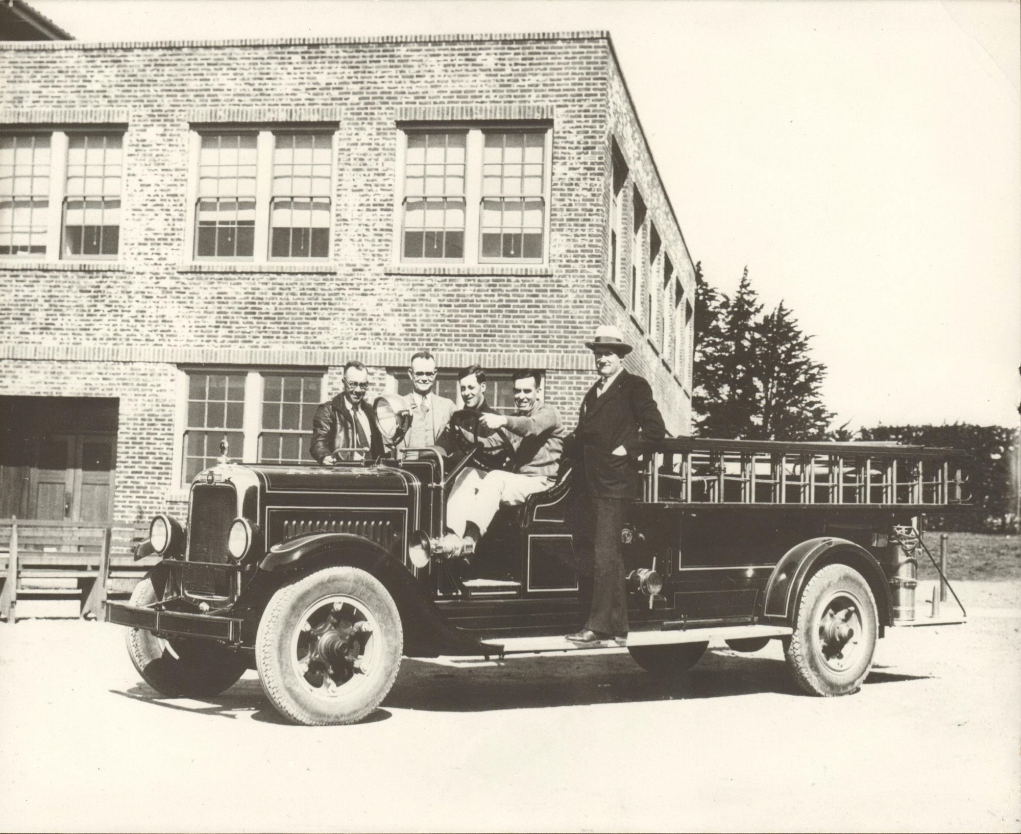 Old photo of people on a vintage engine