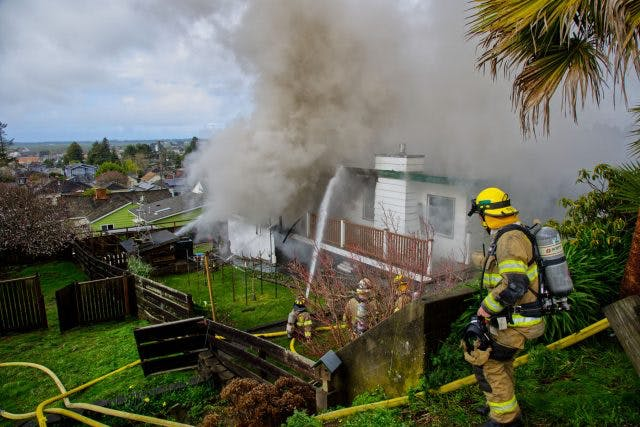 Firefighters at a house fire