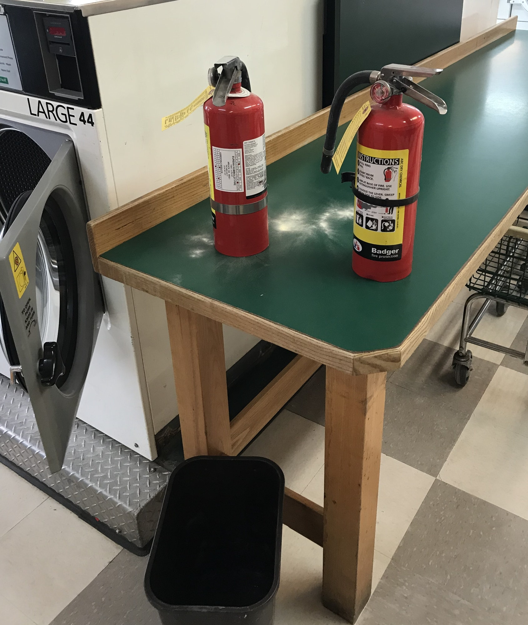 Two expelled fire extinguishers on a table