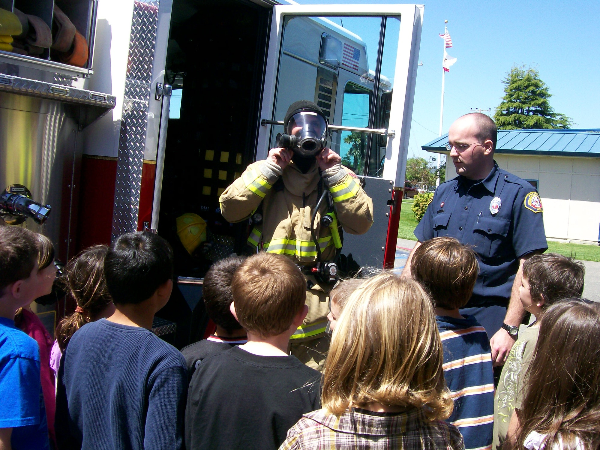 Firefighter in safety gear at a public education event.