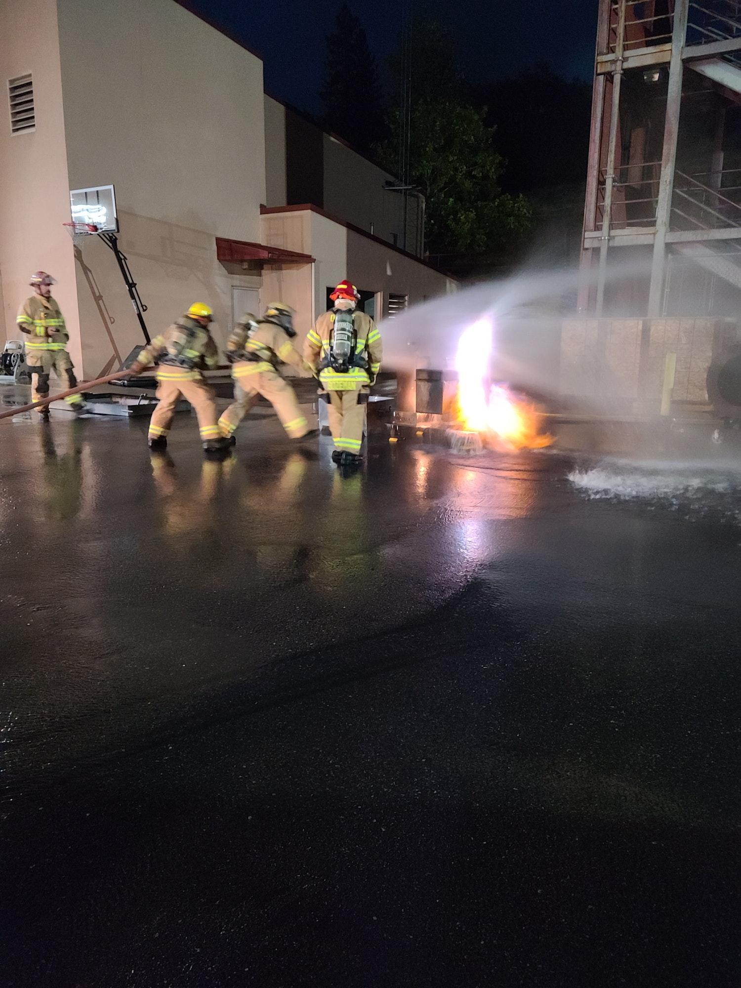 May contain: person, human, fireman, and flooring