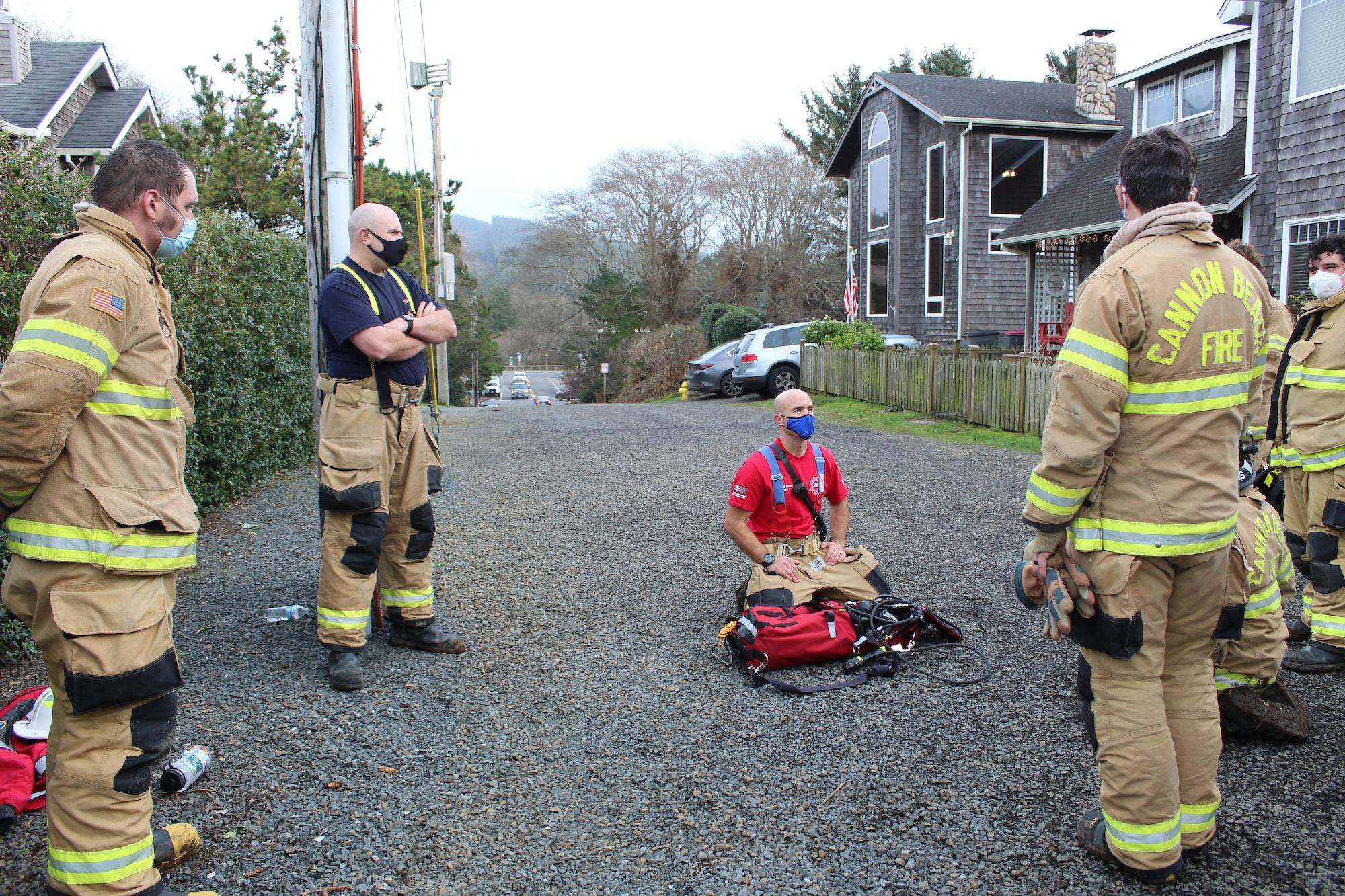 May contain: person, human, tarmac, asphalt, shoe, clothing, footwear, apparel, fireman, and road