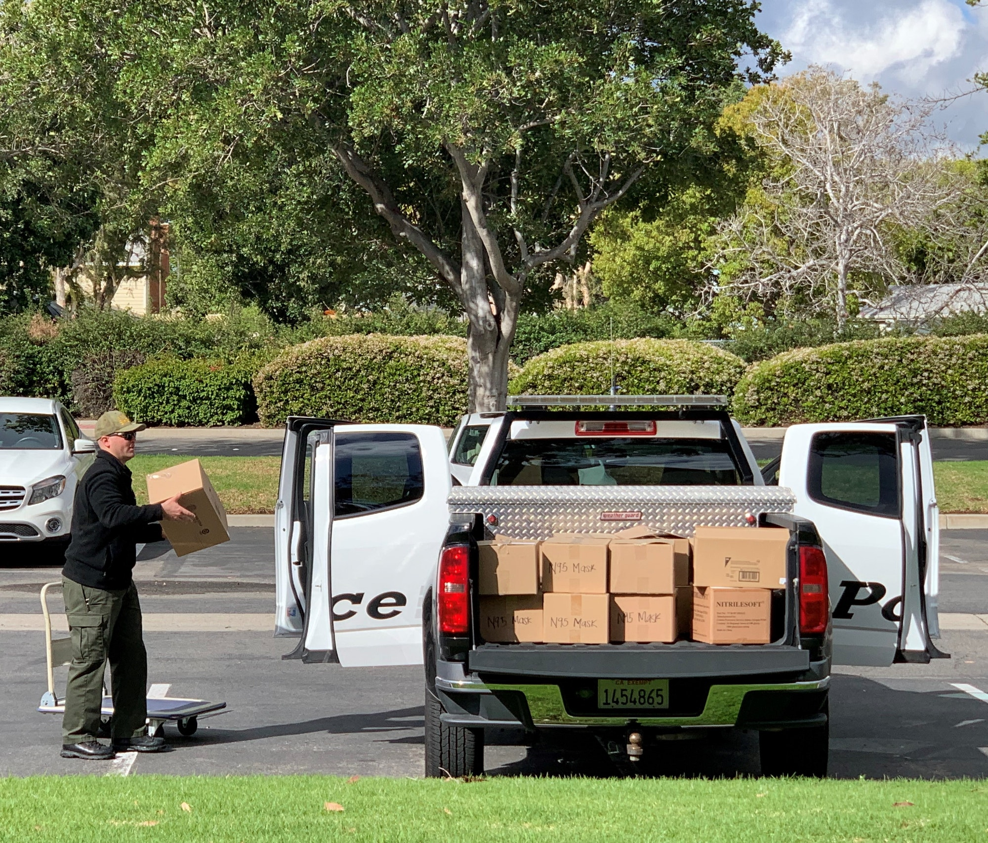 May contain: person, human, vehicle, van, and transportation
