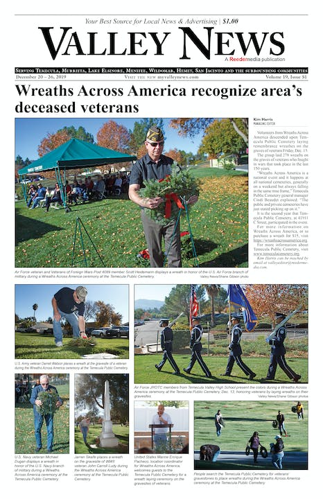 Men and women come togther to lay wreaths on Veterans graves.