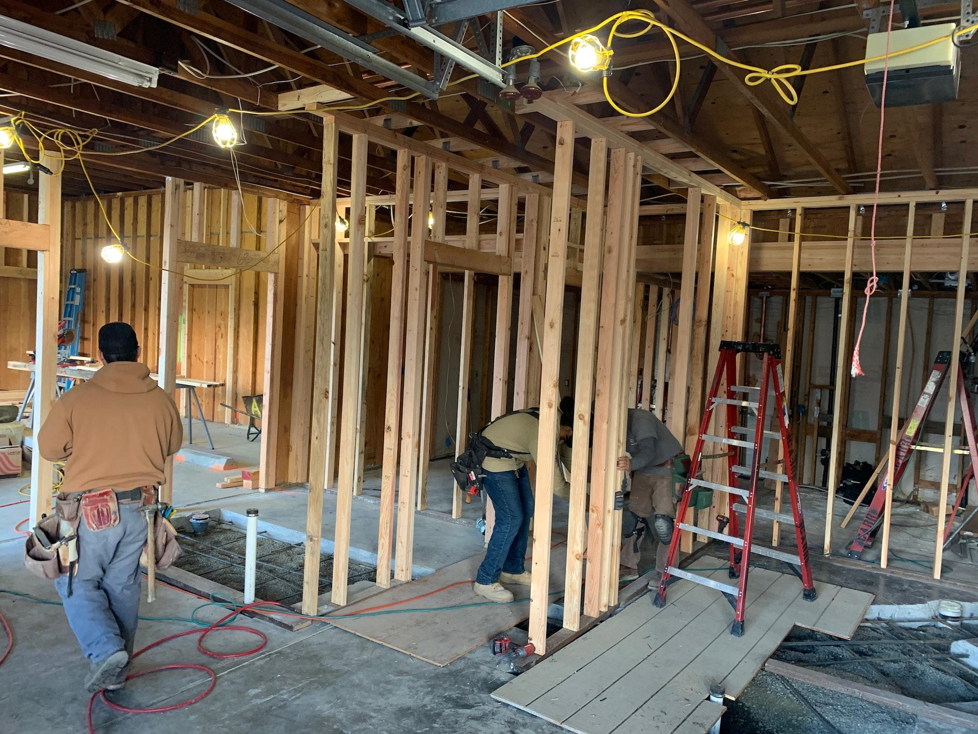 May contain: wood, person, human, plywood, pants, clothing, and apparel