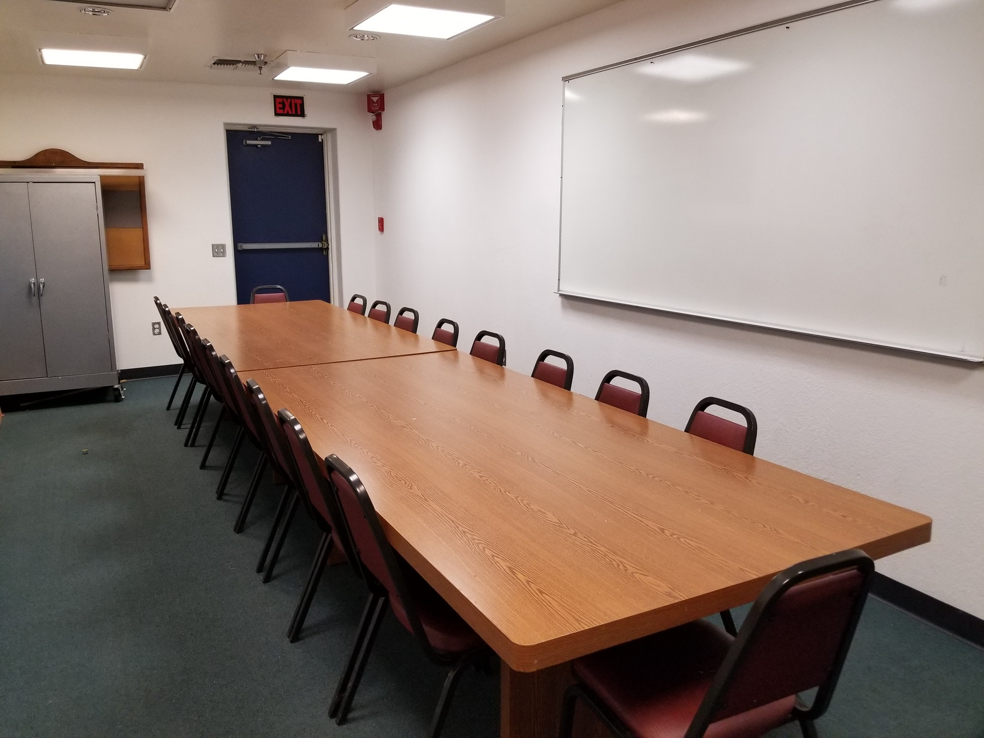 May contain: meeting room, room, conference room, indoors, furniture, and chair