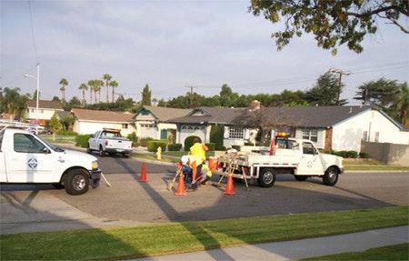 truck servicing street