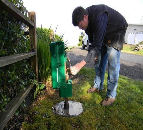 Field employee taking a water sample