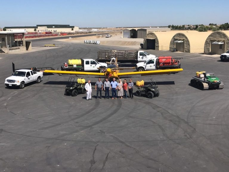 A few of our crew members standing in front of vehicles we use for larvicide and adulticide applications