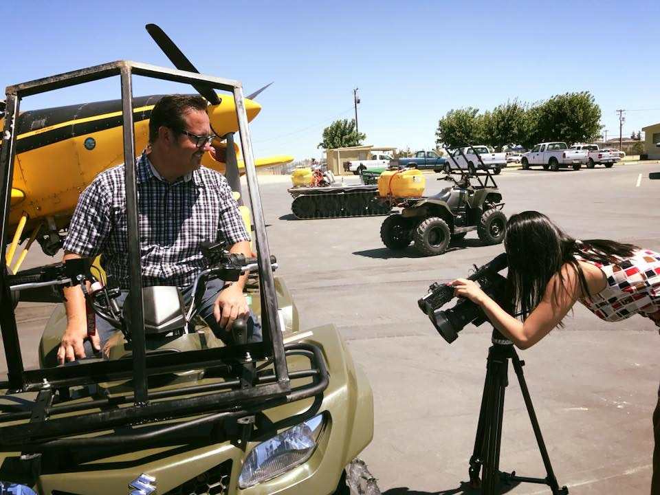Technician on quads being recorded by media
