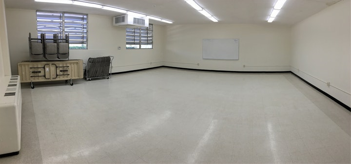 Room 800: Square-like room with white walls, white tile floor, tables and chairs