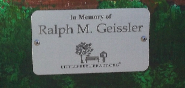 Memorial plaque on Little Free Library