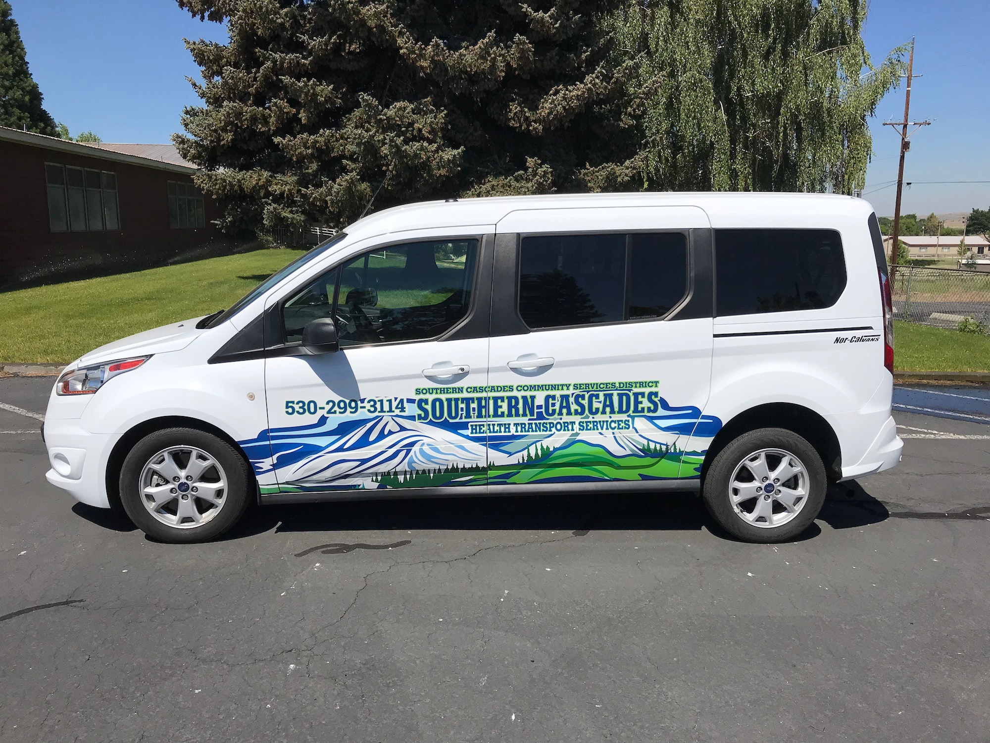 2016 Ford Transit Connect with Southern Cascades Logos