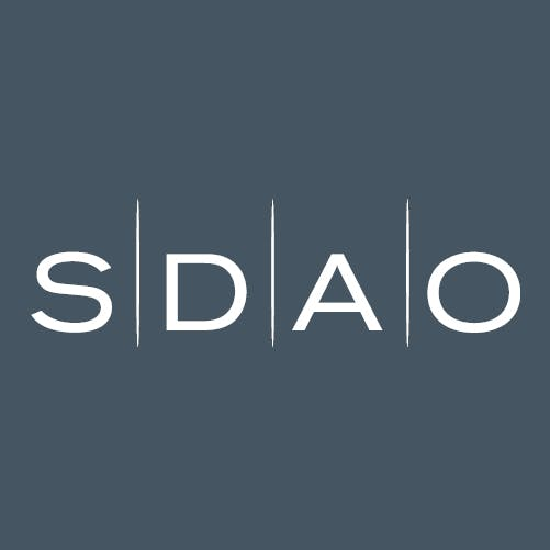 White SDAO logo on dark blue background