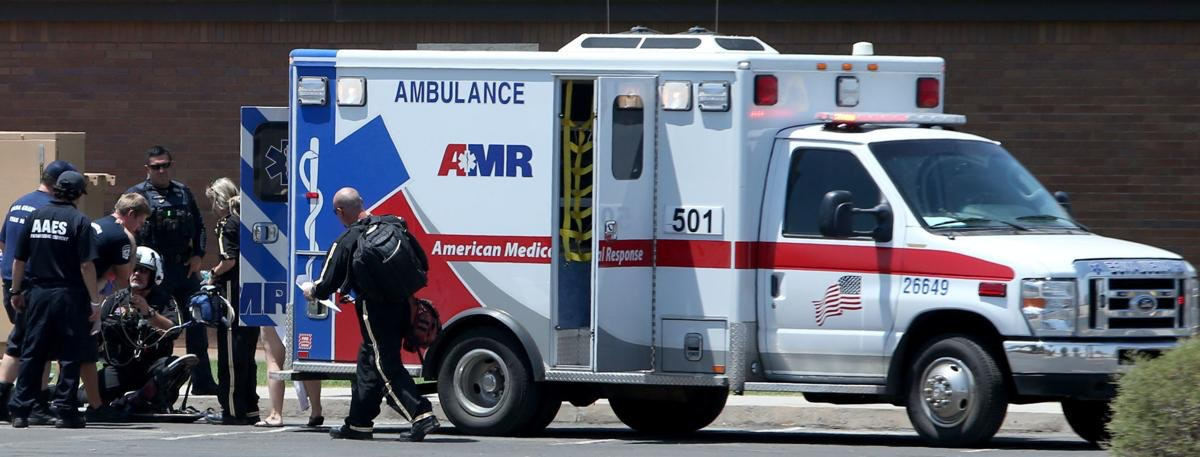 May contain: truck, vehicle, transportation, person, human, ambulance, van, helmet, clothing, and apparel