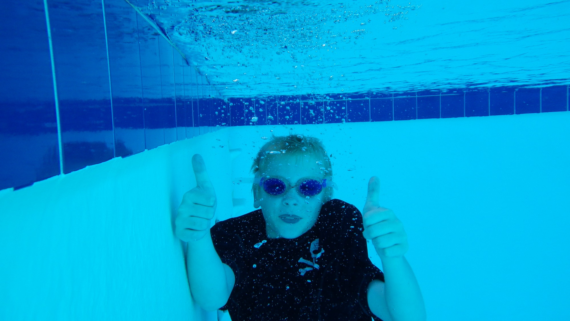 May contain: nature, underwater, outdoors, water, person, human, sunglasses, accessories, accessory, and finger