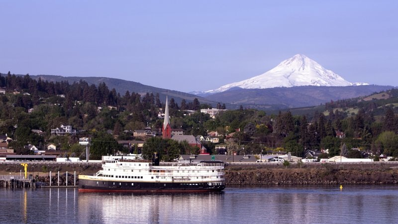 Riverboat on the river with Mt. Hood on the horizon