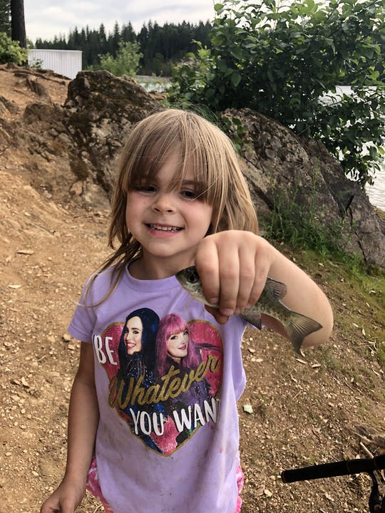 Girl holding a small fish