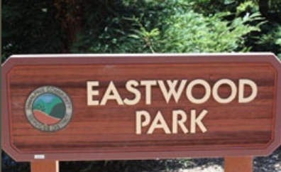 Sign containing TCSD logo and the name Eastwood Park.