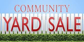Picture of white fence with the words community garage sale.